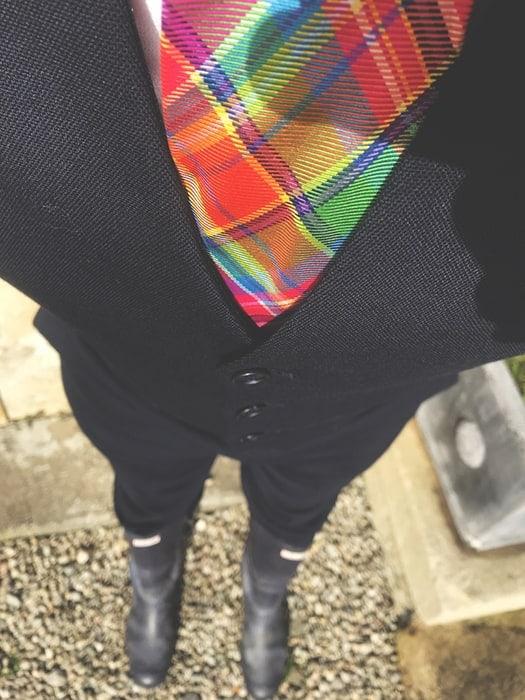 Wedding Photographer wearing wellies with waste coat and tartan tie